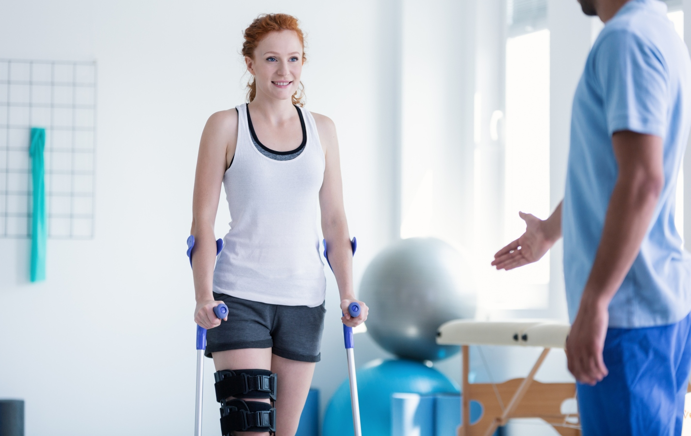 Woman walking with crutches during physiotherapy