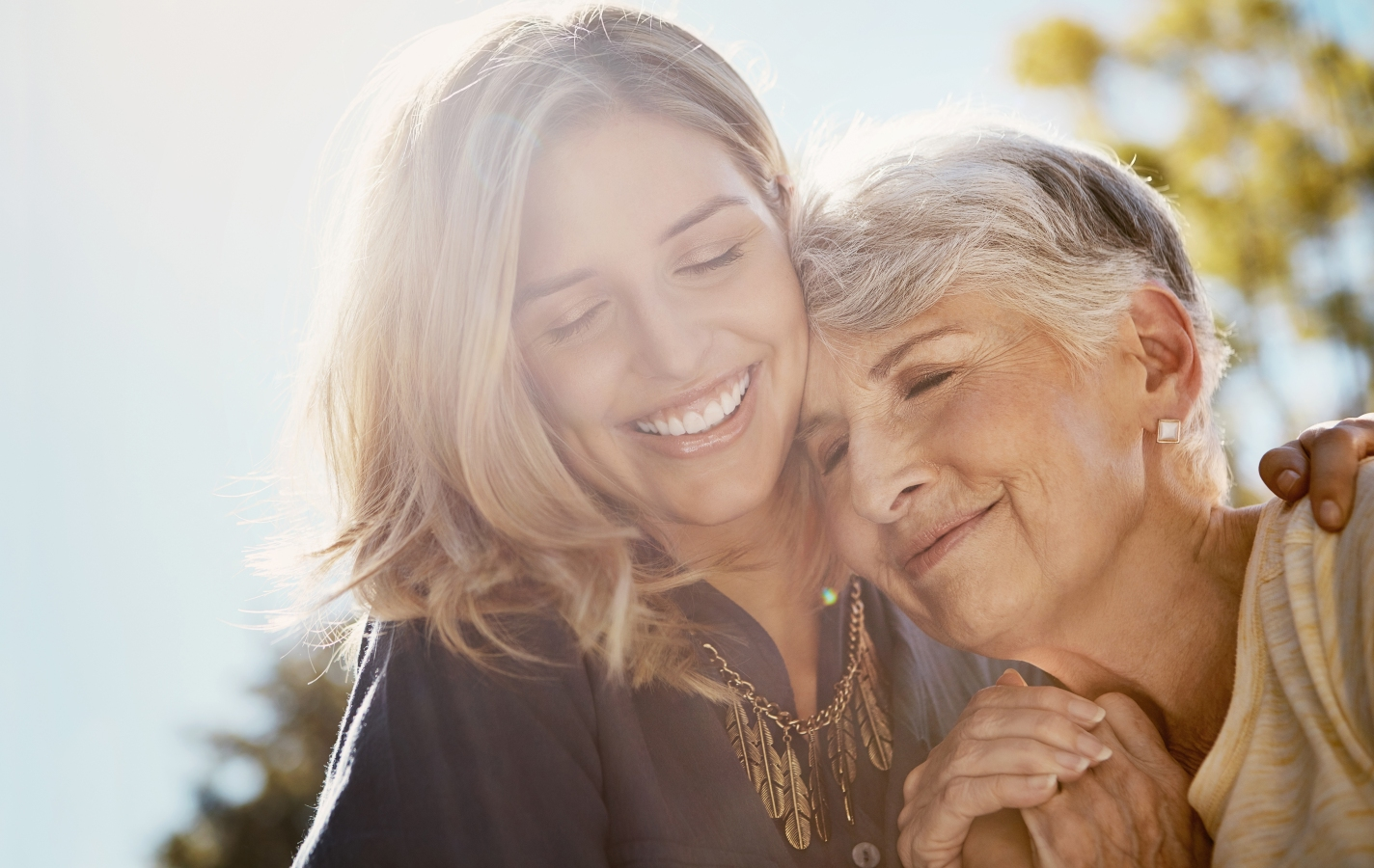 happy senior woman spending quality time with her daughter outdoors