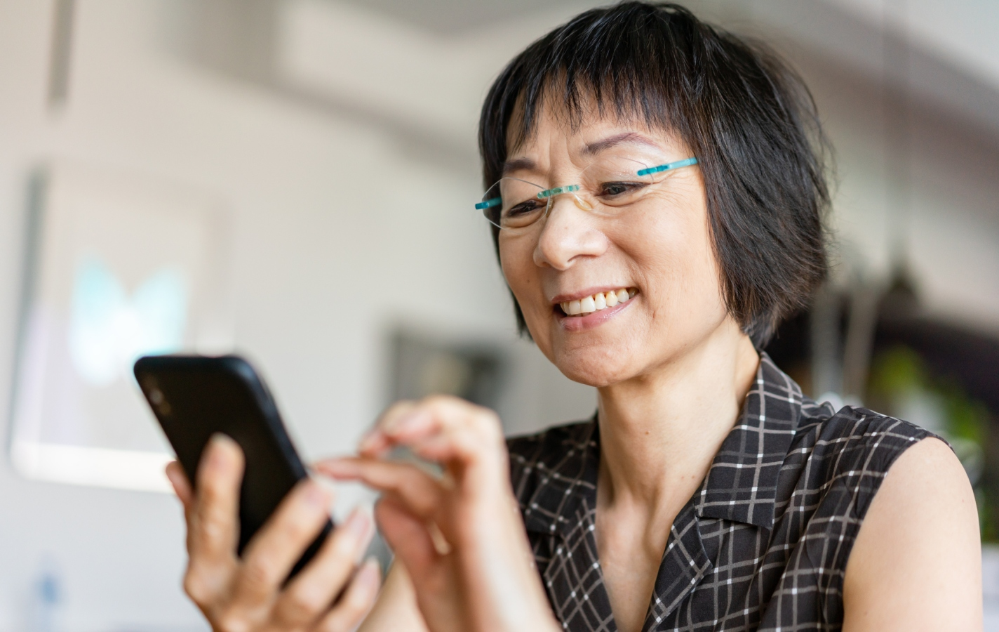 Senior Asian woman using a smartphone