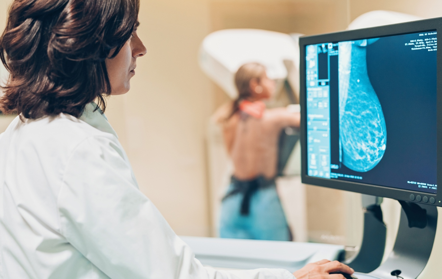 Doctor and patient making a mammography