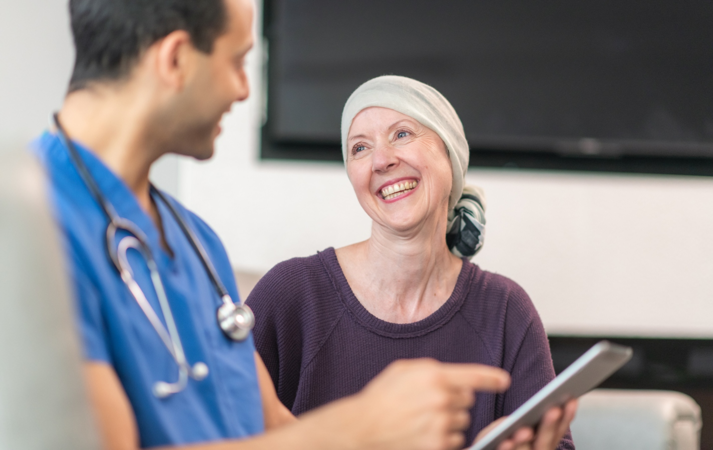 Woman with cancer meeting with doctor