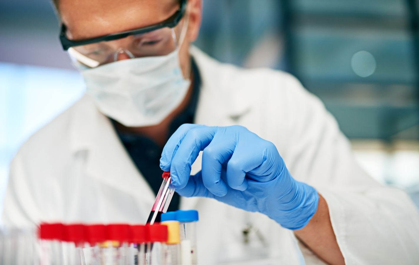 male doctor working with blood samples in his lab