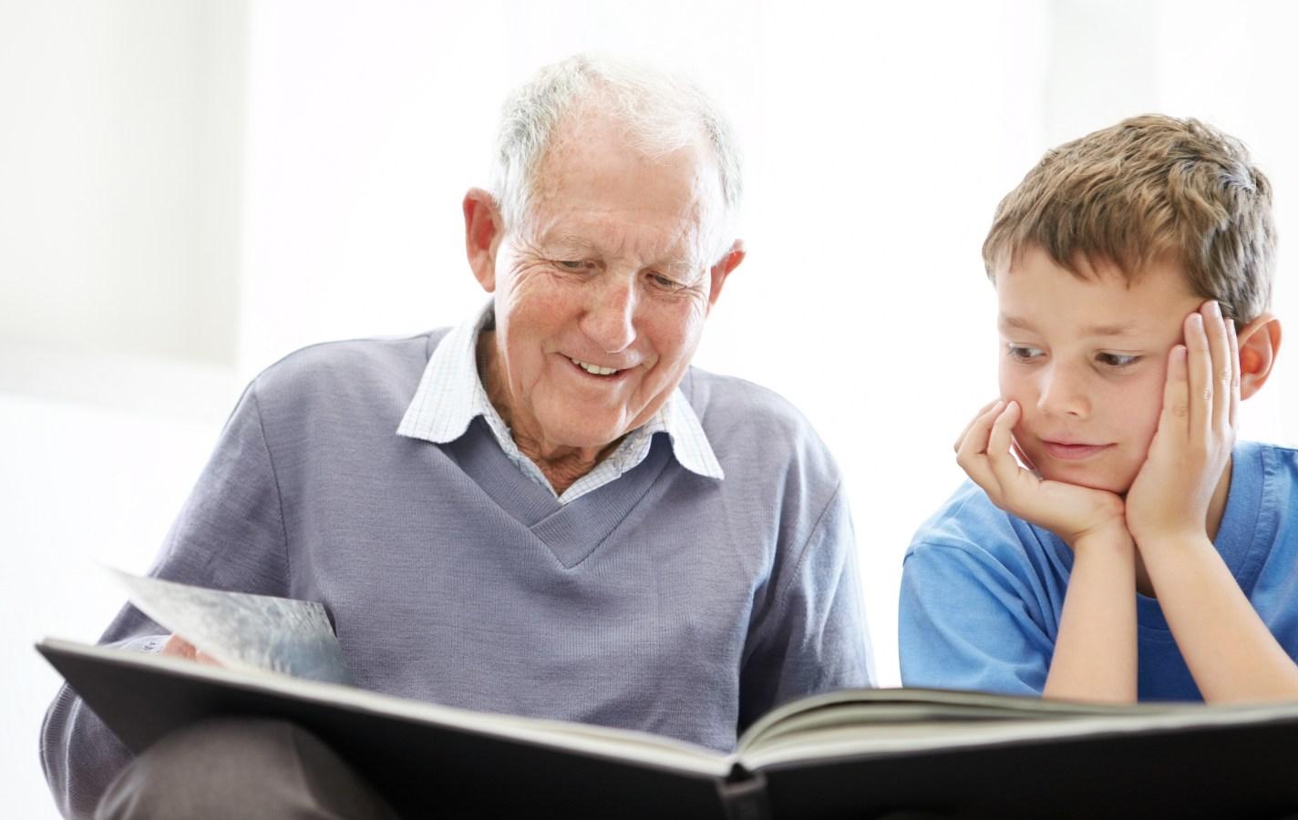 Grandpa and grandson reading a book