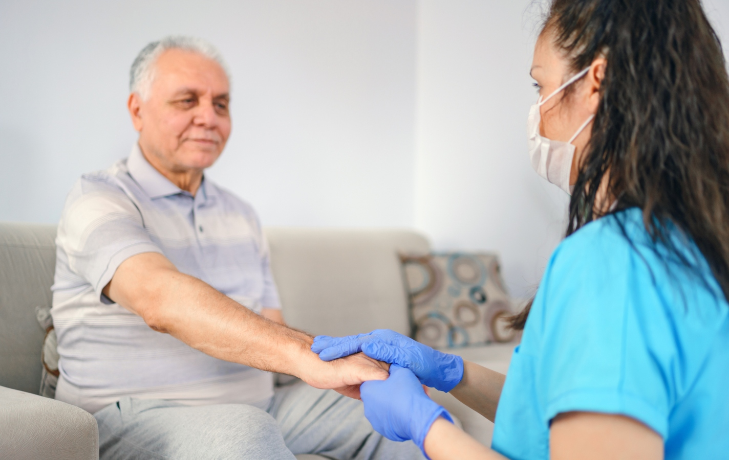 holding elderly patient's hand for health care trust and support