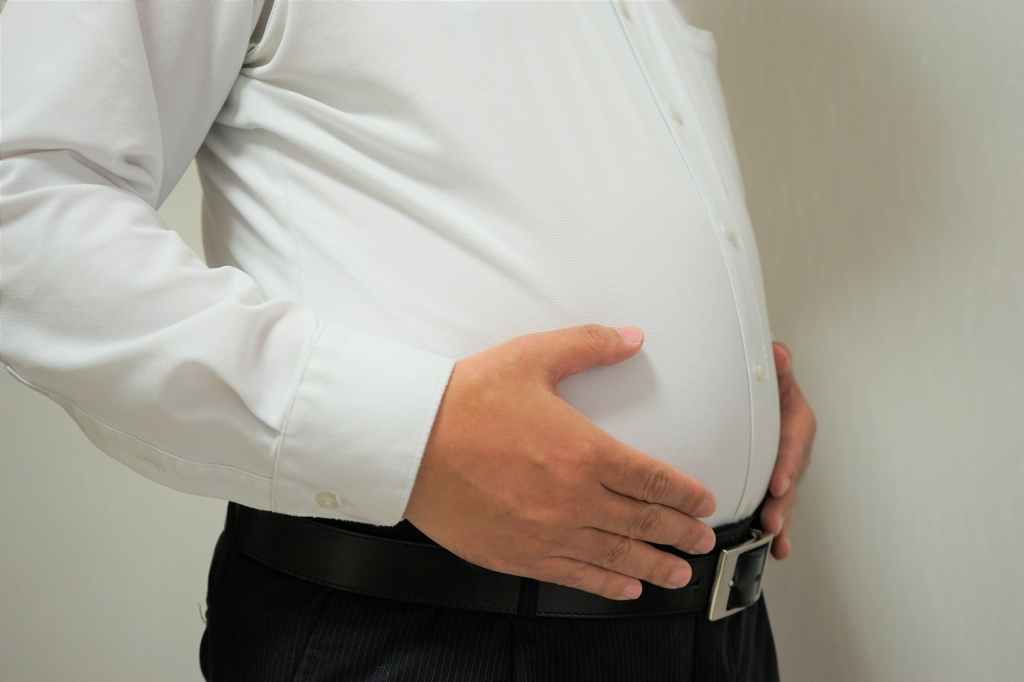 Fat businessman's stomach