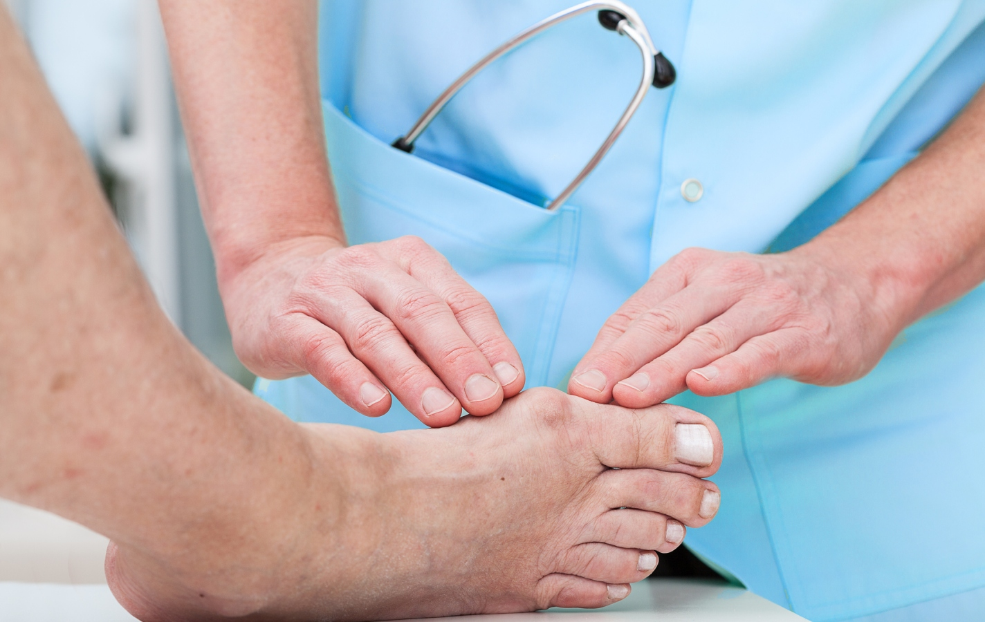 Orthopedist at work checking patient's foot