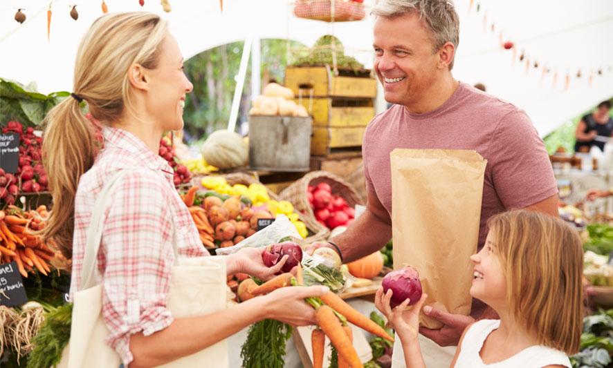 family enjoying day shopping at farmers market