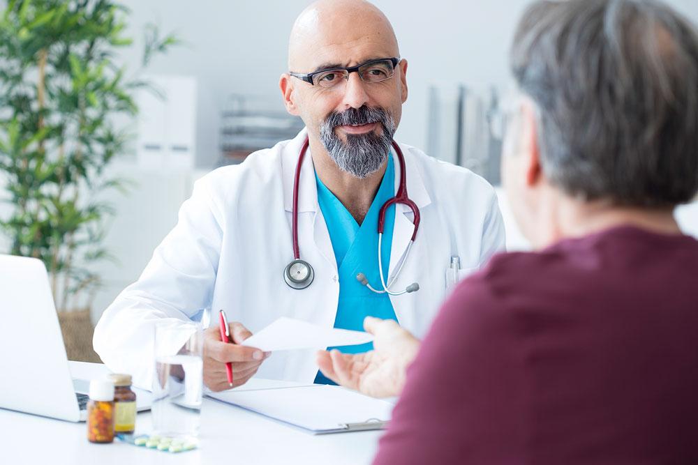 doctor handing patient a document