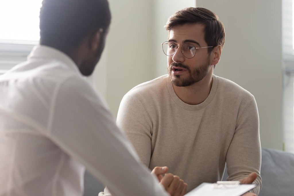 psychologist talking with patient