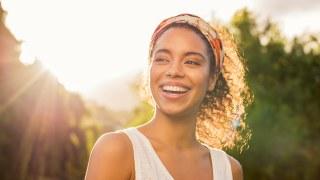 woman smiling enjoying a sunny day